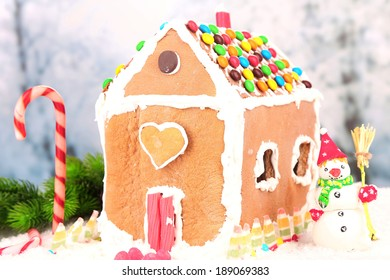 Gingerbread house on light background
