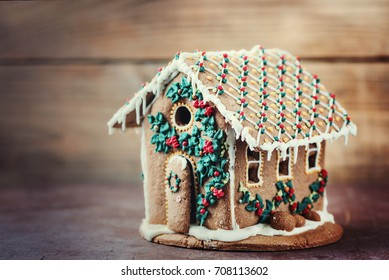 Gingerbread house on a wooden rustic background