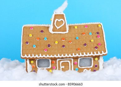 Gingerbread House sitting in freshly fallen snow