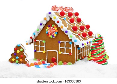 Gingerbread house in snow isolated on a white background
