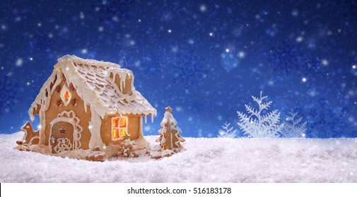 Gingerbread house and snowfall.