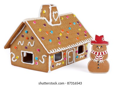 Gingerbread House with Gingerbread Snowman, Isolated