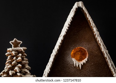 Gingerbread House and tree under the snow Close up roof