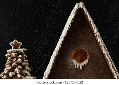 Gingerbread House and tree under the snow Close up roof Snowing