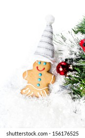 Gingerbread Man Christmas Cookie and Christmas decorations on  white background, closeup. Bright Christmas card.