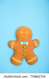 Gingerbread man on the blue background. Christmas and new year concept, copy space for text.