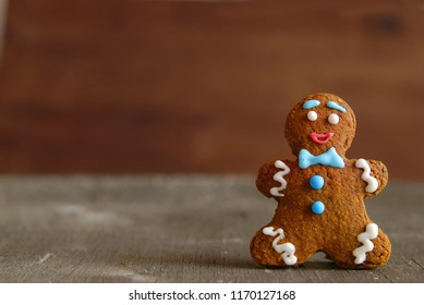 Gingerbread man on a wooden background.