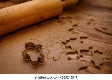 Gingerbread man preparation. Christmas background.