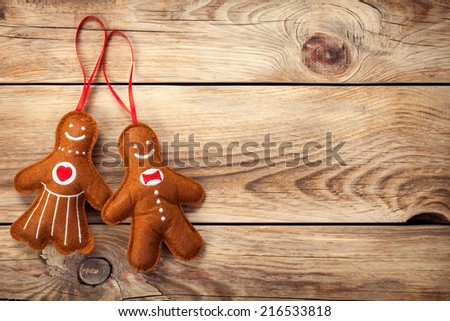 cc538a376b73b Gingerbread man and woman on wooden table background. Christmas composition  with copy space. Top