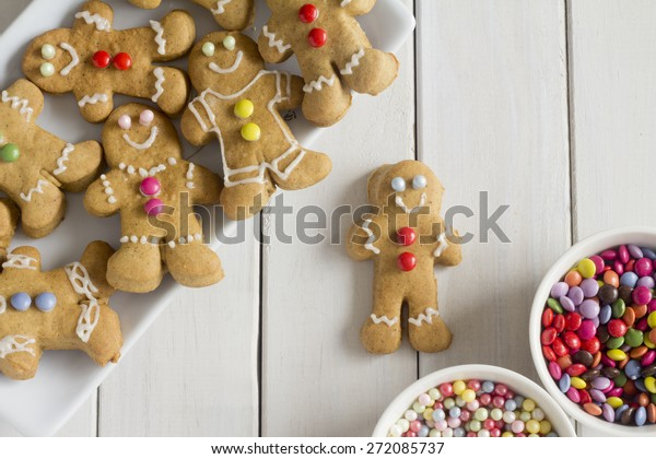 Gingerbread Men with Decorations on a Plate