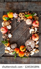 Gingerbread, nuts and fruits for a Merry Christmas /  Happy Holidays