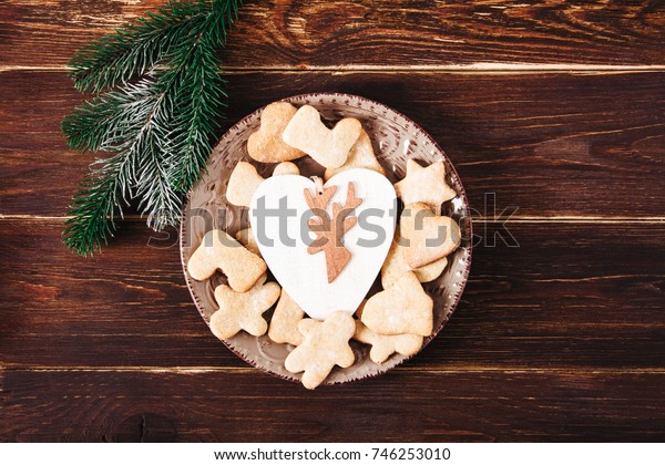 Gingerbread on the wooden breadboard,fir,cinnamon.Christmas,holiday and new year concept.Top view.