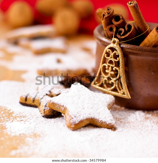 Gingerbread with Powdered Sugar. Symbolic image. Christmas cookies. Wooden background. Close up.