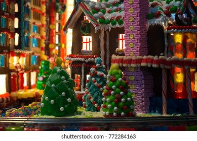Gingerbread village with multi-colors of candy and cookie houses and buildings and decorative Christmas trees. Christmas gingerbread scenery concept