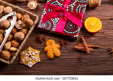Gingerbread, walnuts and gift on a wooden table