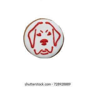 Ginger-honey round gingerbread  with a dog. Isolated on white.