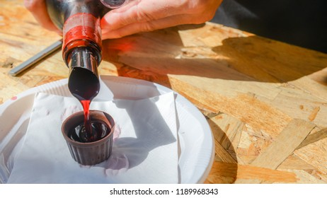Ginja de Obidos, traditional sour cherry liquor, served in small cups made of chocolate