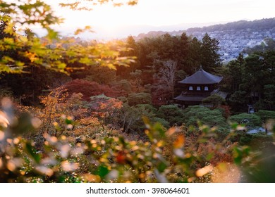Ginkakuji, the famous pavilion in Kyoto, Japan during sunset with lens flare