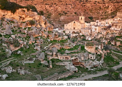 Ginosa, Taranto, Puglia, Italy: landscape of the old town with the ancient church and the cave houses carved into the rock in the village near Matera