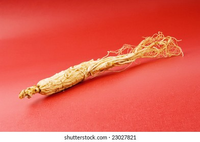 the ginseng on the red background