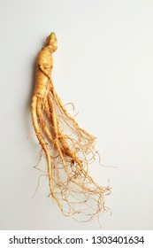 Ginseng root on white background