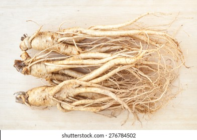 ginseng root on wood board