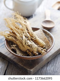 Ginseng root on wooden background, Herbs for health.