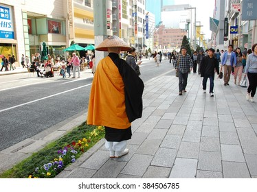 Ginza Tokyo, April 17 2015: Buddhist Monk asking for donation in Ginza. Ginza is a luxurious shopping area in Tokyo, Japan.