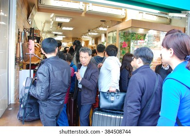Ginza Tokyo, April 17 2015: Chinese tourists making a line to buy suitcases in Ginza, Tokyo. Bakugai (explosive buying) by Chinese travelers has been a recent phenomenon.