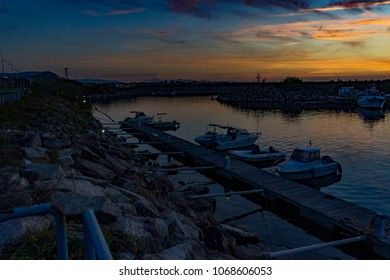 Gioia Tauro , Italy - APRIL , 2018:  marine port, sunset with strong and colored lights of Reggio Calabria