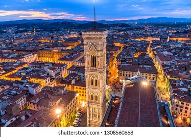 Giotto's Campanile - An aerial dusk view of Giotto's Campanile and the historical Old Town of Florence, as seen from the top of Brunelleschi's Dome of the Florence Cathedral. Florence, Tuscany, Italy.
