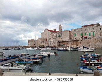GIOVINAZZO, ITALY - JULY 16, 2016: View of the lovely port at the Adriatic Sea of Giovinazzo, Apulia, southern Italy.