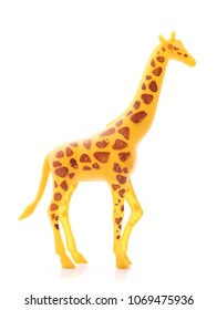 giraffe made out of plastic. animal toy isolated on white background