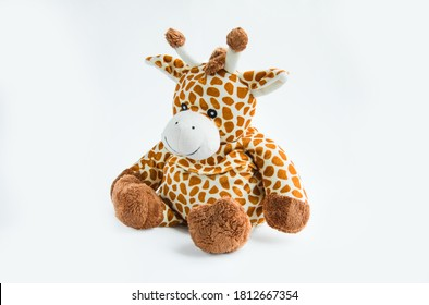 Giraffe plush toy isolated on a white background with shadow reflection. Colorful children's plush toy. Colored stuffed giraffe toy for a child. White and brown giraffe