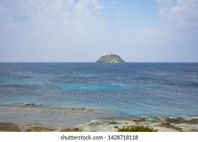 The Giraglia island in front of Barcaggio beach. Sentier des douaniers. Corsica, France