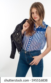 Girl 13 years. Blue jeans striped shirt worn by a girl