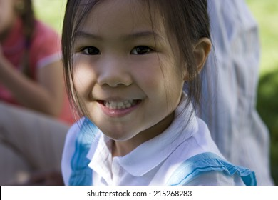 Girl (3-5) smiling, close-up, portrait, focus on foreground