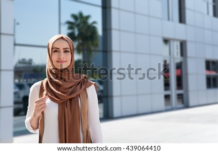 girl in abaya on the background of the business center