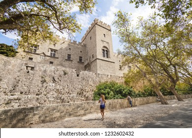 Girl admires Grand Master palace in City of Rhodes (Rhodes, Greece)