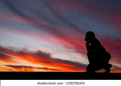 Girl admires the sunset, beautiful bright sky, silhouette