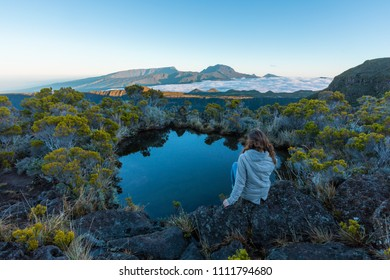 Girl admiring the Piton des Neiges in Reunion Island