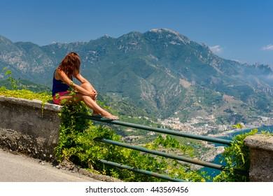 Girl admiring a scenic view of Amalfi coast, Ravello, Campania, Italy.