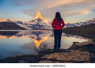 Girl admiring the Swiss Alps and Matterhorn peak in the background, Zermatt, Stellisee, Switserland
