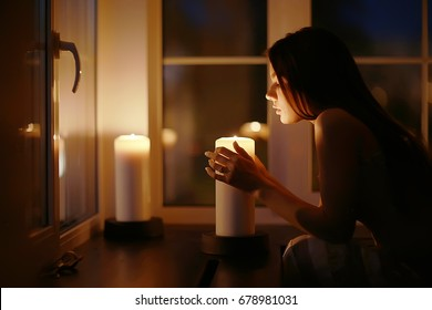 Girl adult evening candles romance holiday christmas home portrait