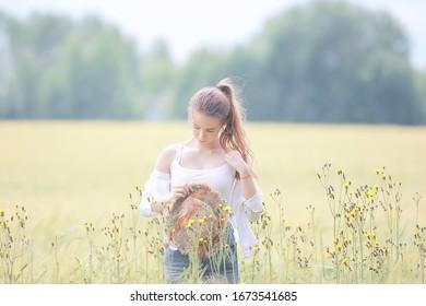 girl adult field hat happiness / european landscape girl in the field, straw hat, happy look