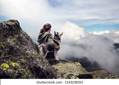 Girl adventure on the mountain with her dog