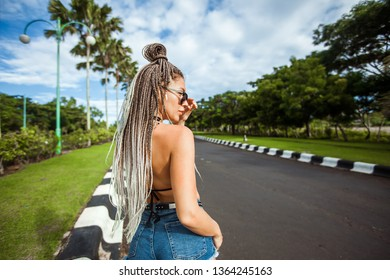 Girl with African braids. view back