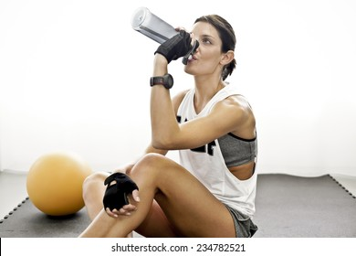 Girl after training drinks water
