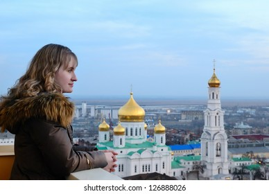 Girl against church. Russia. Rostov-on-Don. A cathedral of the Virgin.