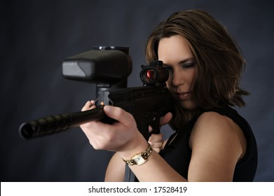 Girl aiming to shoot